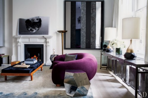 by-Francis-Sultana.-Jean-Royère-sofa-is-grouped-with-Bonetti-polished-steel-side-tables-and-a-Charlotte-Perriand-bench